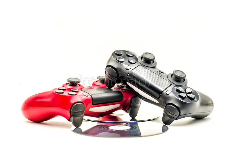 Two game controllers on cds isolated on white stock photography