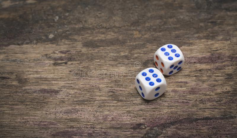 Two game dice on the wooden table number six stock image