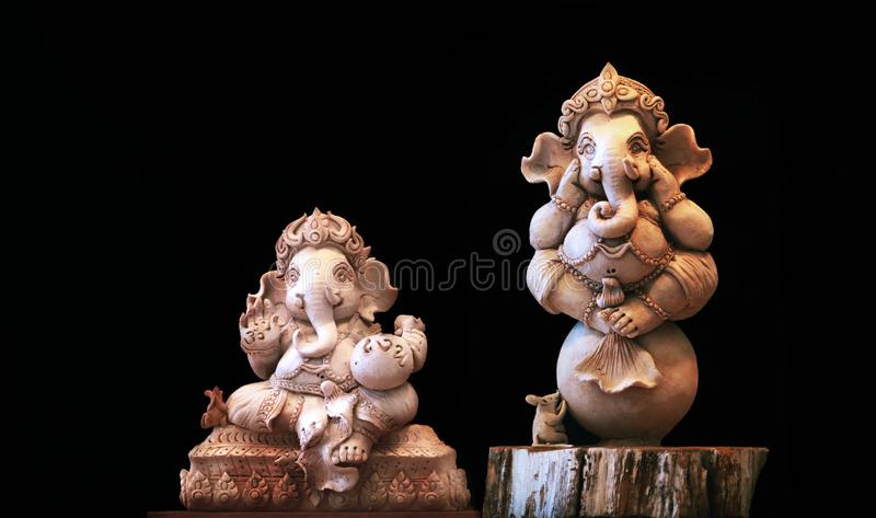 Ganesh statue On the background is a black scene royalty free stock image
