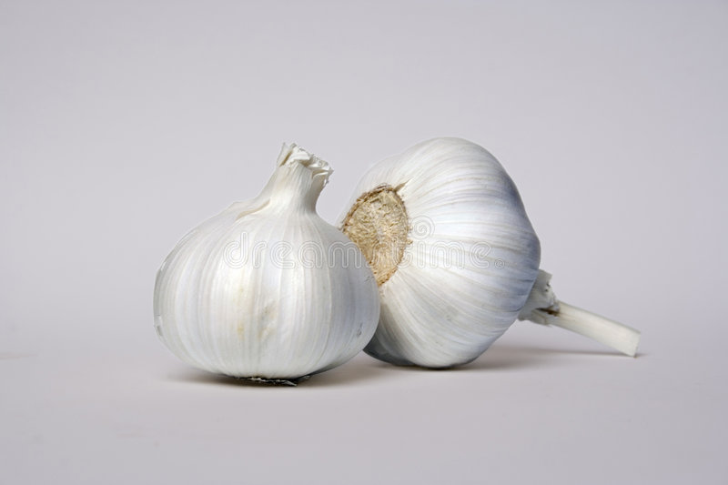 Two Garlic Cloves Royalty Free Stock Images