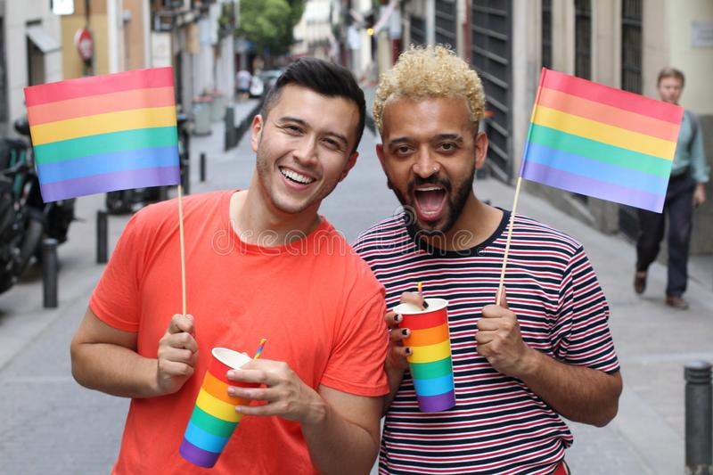 Two gay men partying outdoors stock photos