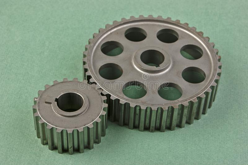 Two gears. On a green background royalty free stock photos