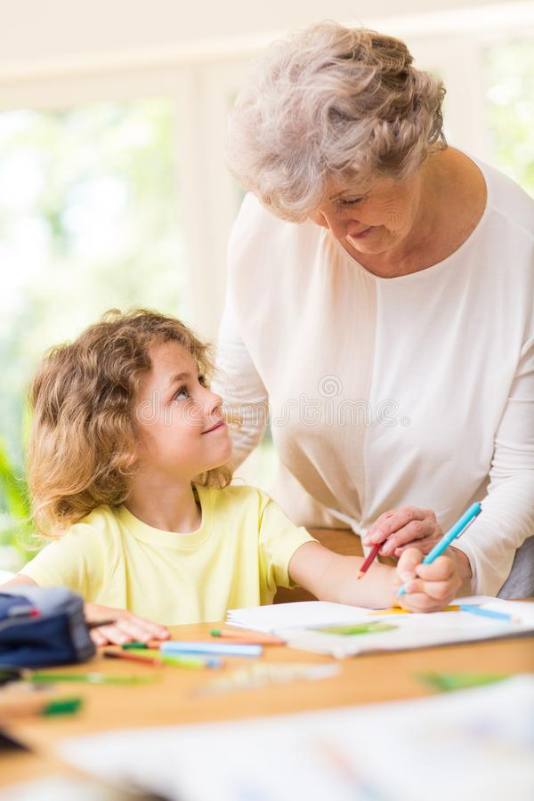 Two generations having fun with a drawing stock photos