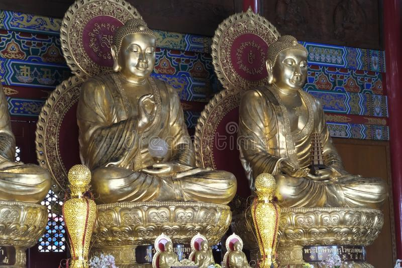 Two Giant Buddha Images sitting on lotus flowers. Yesterday,I travel to visit the most beautiful Chinese temple in a province nearby the capital city of Thailand stock image