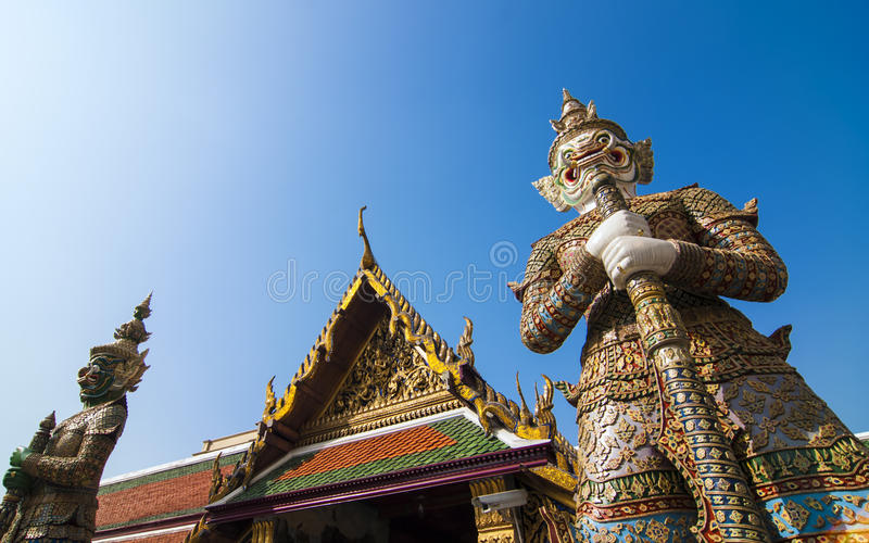 Two Giant keepers at Grand Palace. Giant keeper was a legend in Thailand culture. Giant keepers guard temple in Grand palace. Grand palace is one of Thailand stock image