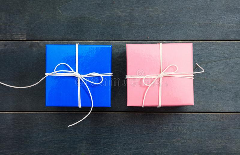 Two gift boxes on blue background, copy space, top view stock photos