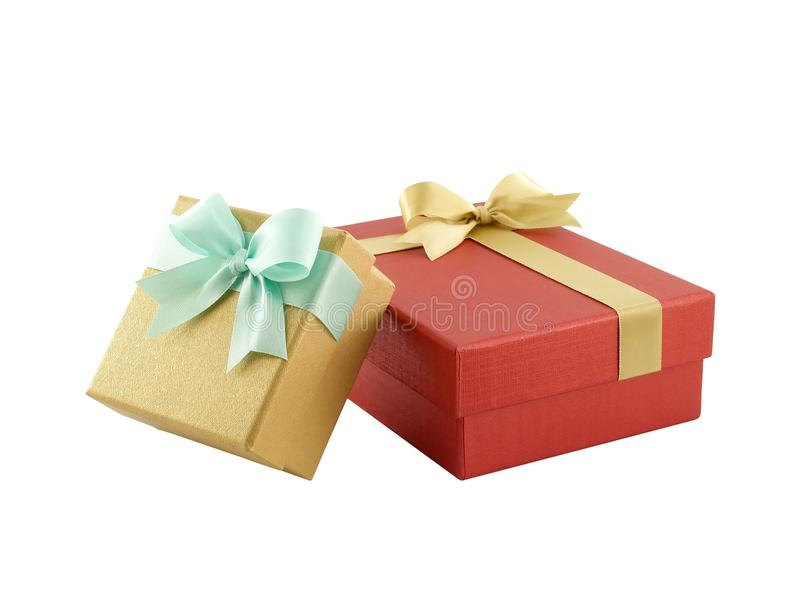 two gift boxes (yellow gold box with mint green ribbon bow and red box with golden ribbon bow) isolated on white royalty free stock photos