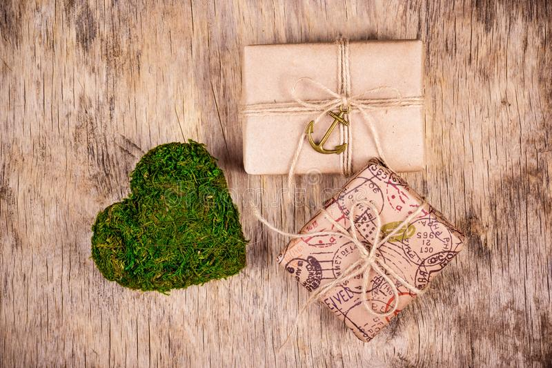 Two gift boxes and green heart made of moss. St. Valentine`s Day. Romantic concept. royalty free stock photos