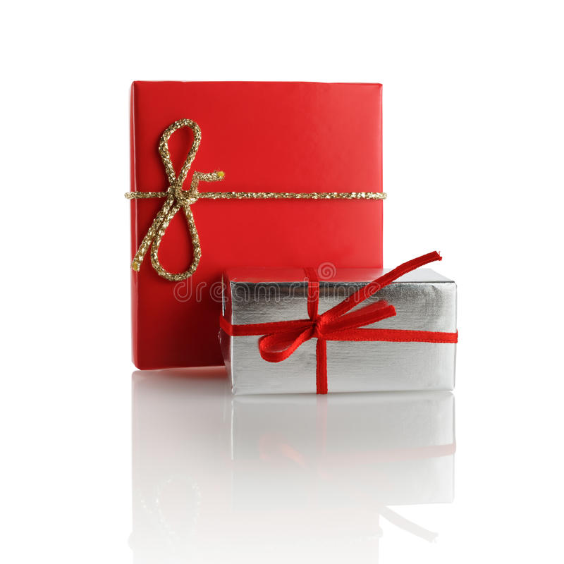 Two gift boxes. Red and silver gift boxes on a white background. Isolated with clipping path royalty free stock photos
