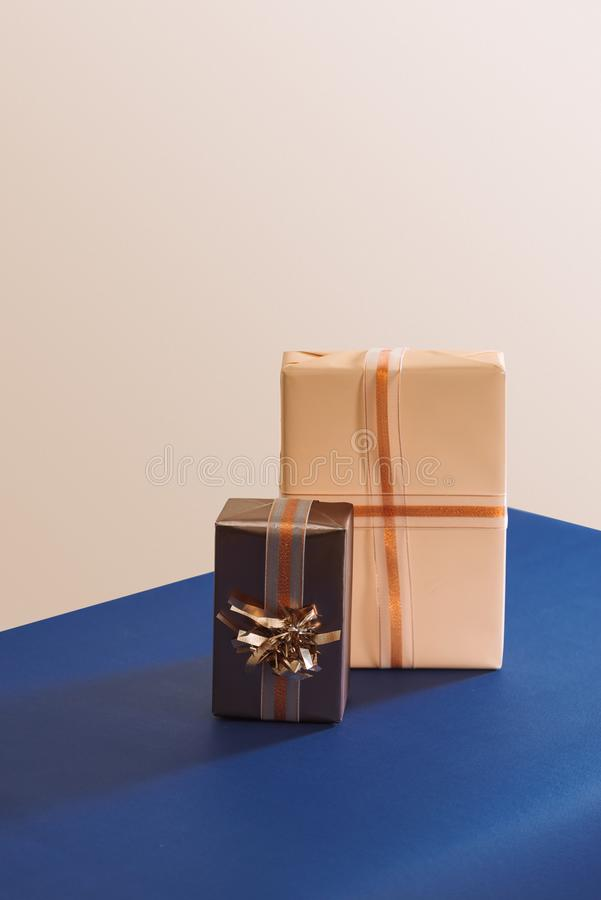 Two gifts boxes with ribbons on blue background.  royalty free stock photo