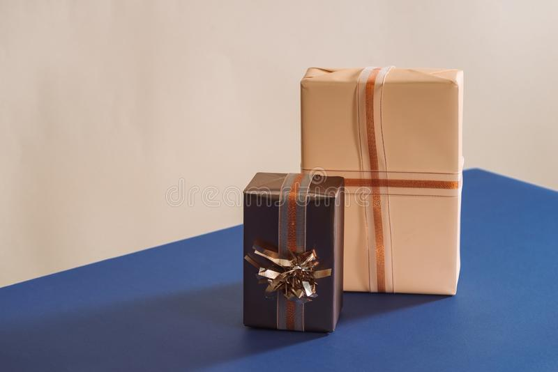 Two gifts boxes with ribbons on blue background.  royalty free stock images