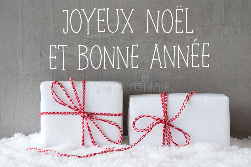 Two Gifts With Snow, Bonne Annee Means Happy New Year. French Text Joyeux Noel Et Bonne Annee Means Merry Christmas And Happy New Year. Two White Christmas Gifts royalty free stock photography