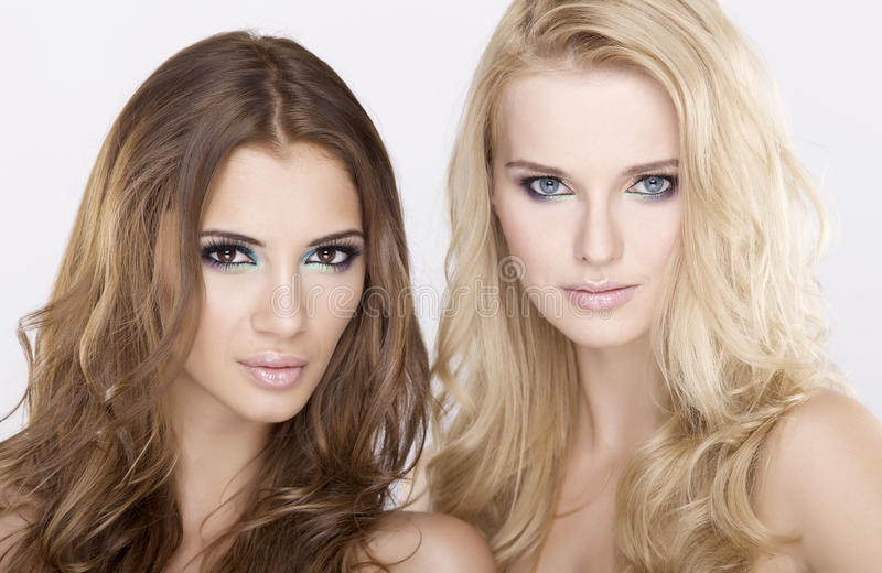 Two girl friends - blond and brunette royalty free stock images