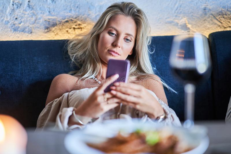 Two girl friends eating lunch in restaurant. Picture of two girl friends eating lunch in restaurant royalty free stock photos