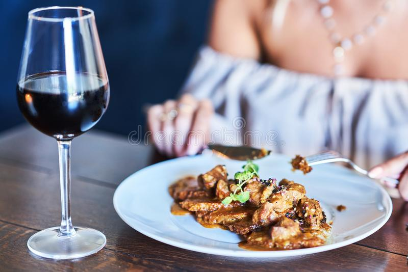 Two girl friends eating lunch in restaurant. Picture of two girl friends eating lunch in restaurant royalty free stock photo