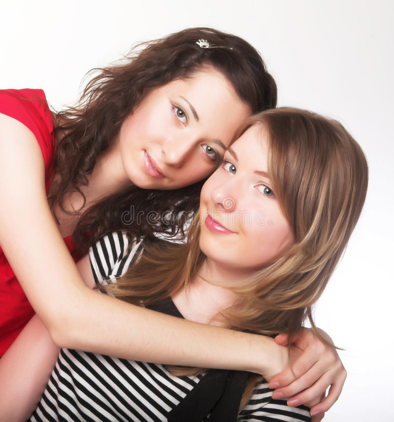Two girl friends together smiling stock photography