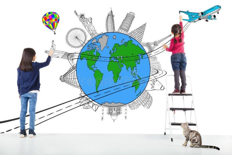 Two girl kids drawing worldwide map and famous landmark stock photography