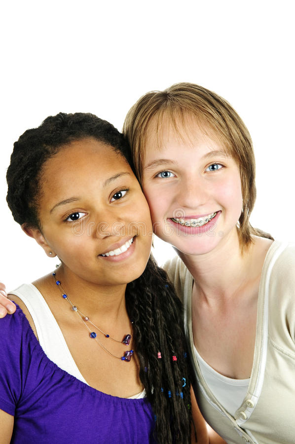 Two girlfriends. Isolated portrait of two diverse teenage girl friends stock images