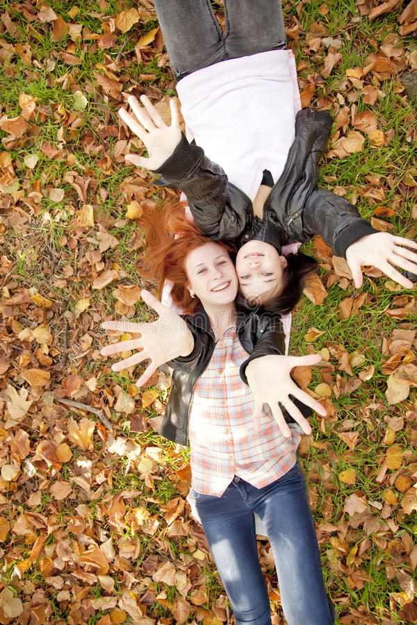 Two girlfriends at the autumn park. royalty free stock photo