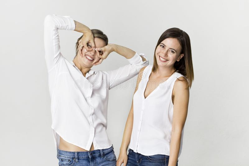 Two girlfriends having fun at studio. Two young woman smiling portrait stock images