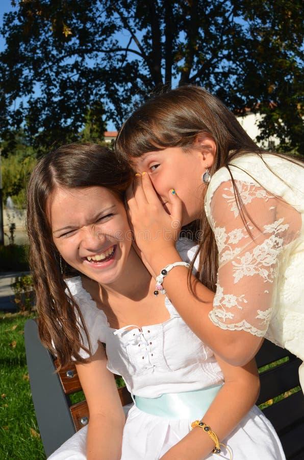 Best friends gossip stock image