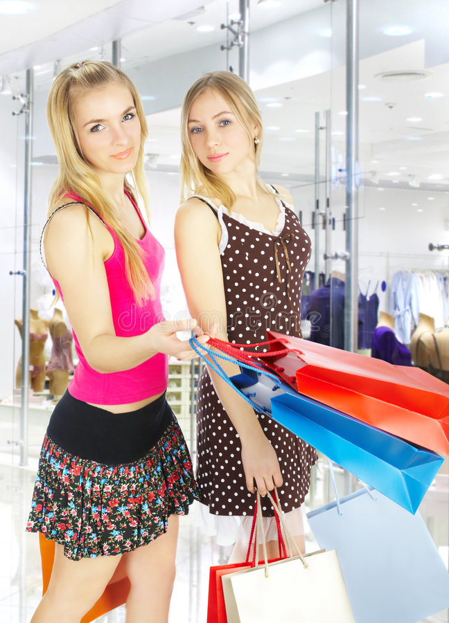 Download Two Girls With Bags - Comparison Shopping. Sale! Stock Photo - Image of lifestyles, female: 4606450