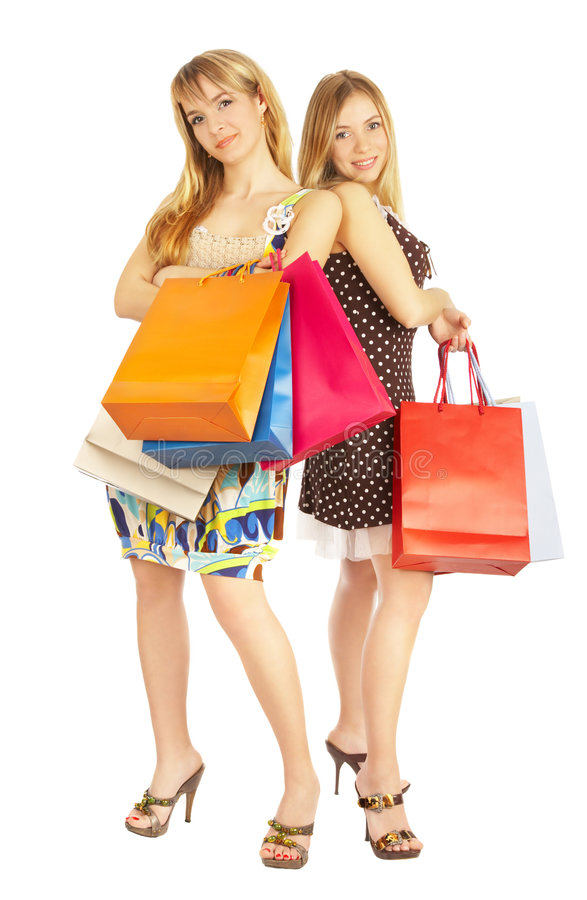 Two Girls With Bags - Comparison Shopping. Sale! Royalty Free Stock Images