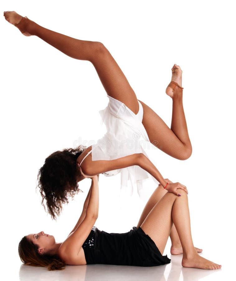 Two girls ballet dancers making stock image