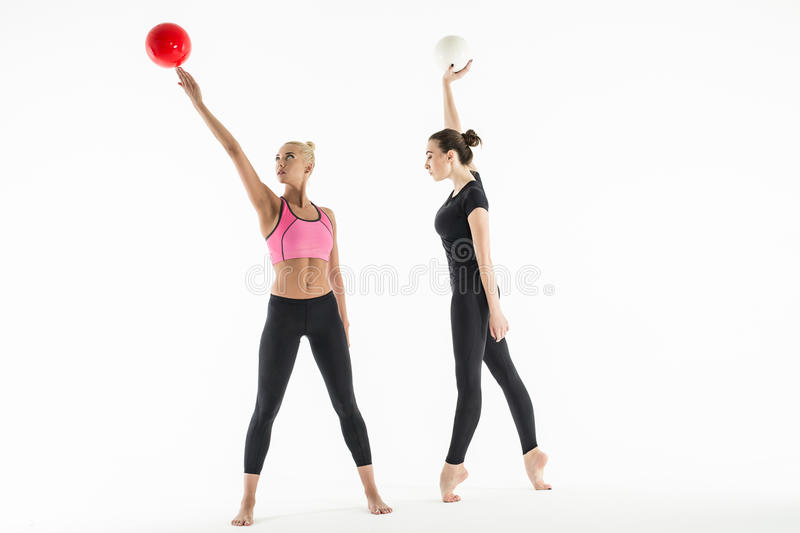Two girls with balls royalty free stock images