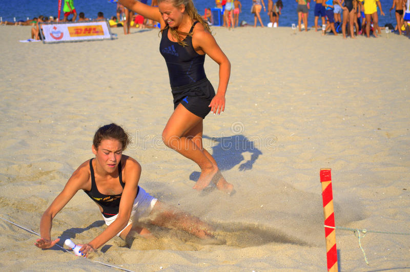 Two girls at beach race final royalty free stock images