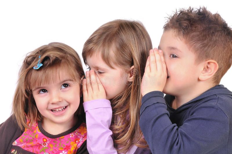 Two girls and a boy gossiping. On the white background royalty free stock image