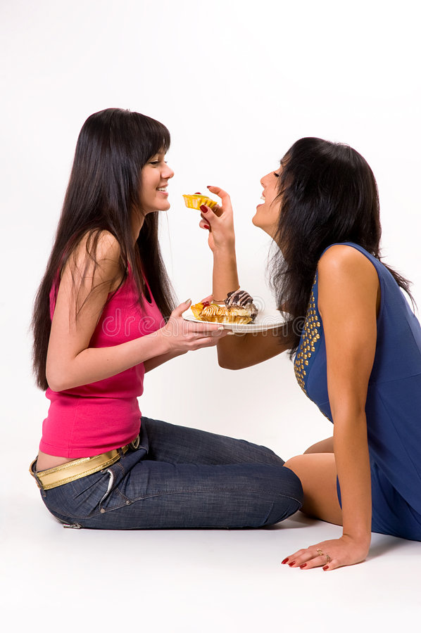 Two girls with cakes. Two beautiful girls with cakes royalty free stock photography
