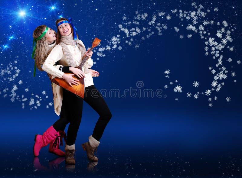 Two girls Dancing with balalika royalty free stock photography