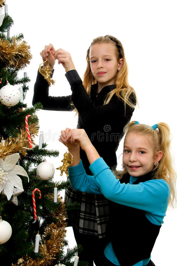 Download Two Girls Decorating Christmas Tree Stock Image - Image: 12253401
