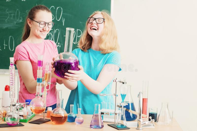 Girls doing chemical experiments. Two girls doing chemical experiments royalty free stock photo