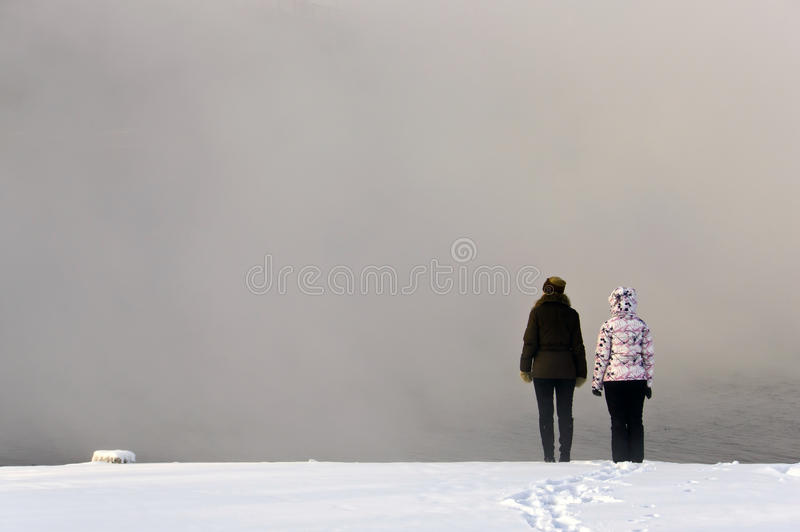 Two girls on the edge of the mist royalty free stock photos