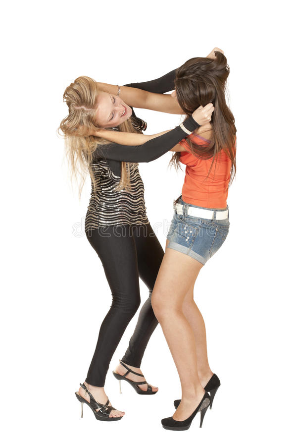 Two girls fighting hair pulling royalty free stock images
