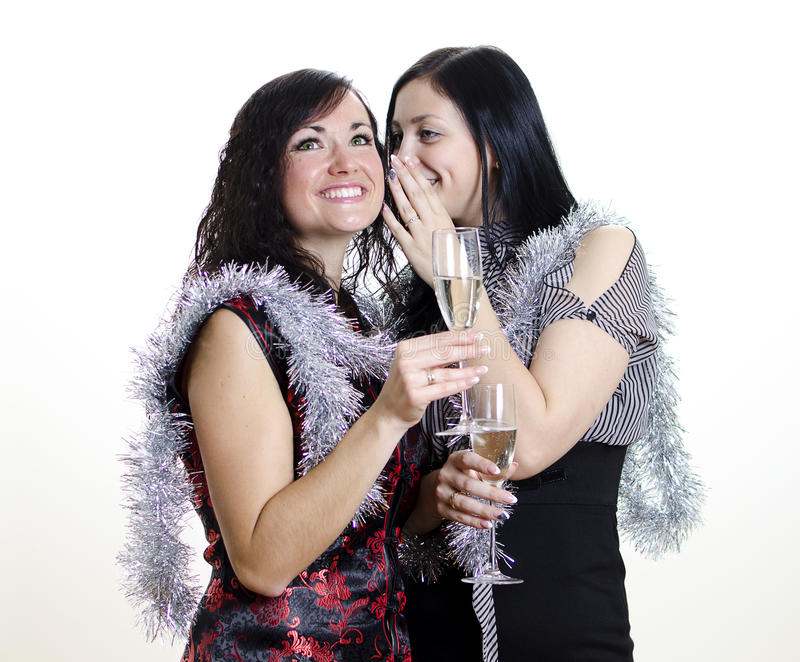 Two girls gossiping. At the party royalty free stock photography