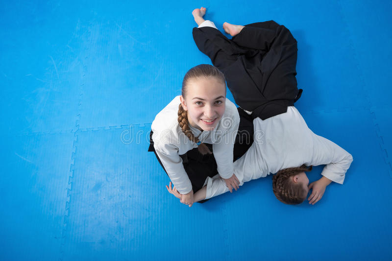 Two girls in hakama on Aikido training royalty free stock image