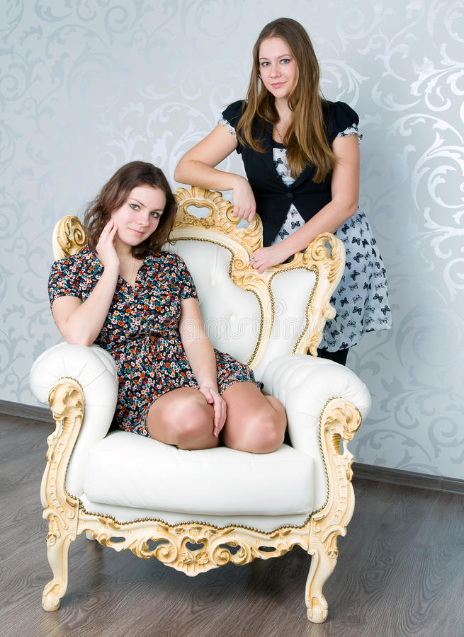Two girls. Two happy beautiful girl in the studio royalty free stock photography