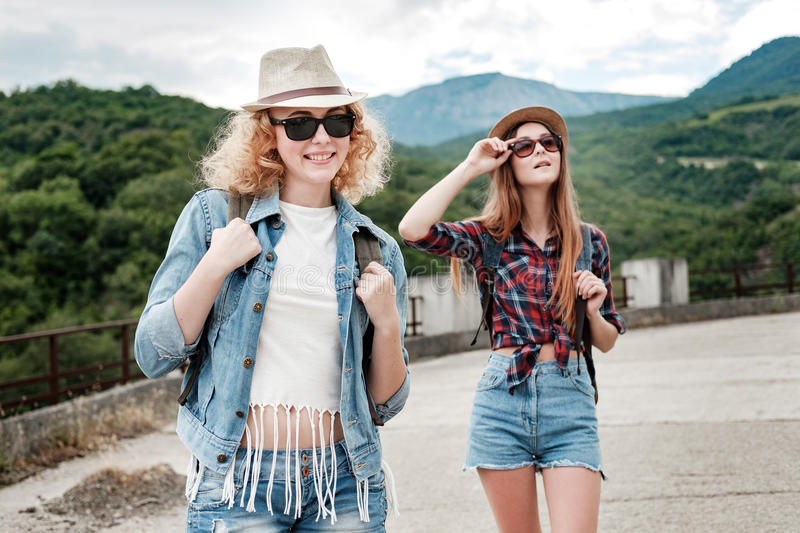 Two girls in hats traveling through ruins stock photography