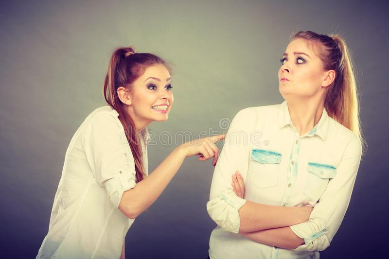 Two girls having argument, interpersonal conflict. Interpersonal conflict, bad relationships, friendship difficulties concept. Quarrel between two young women stock image