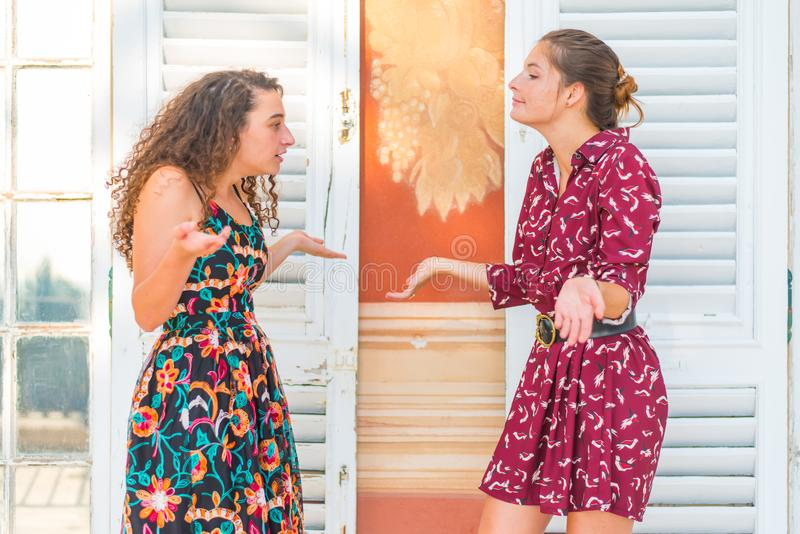 Two girls having an argument, what are you saying stock image