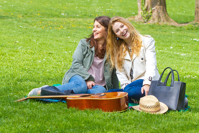 Two girls having fun in the park stock photos