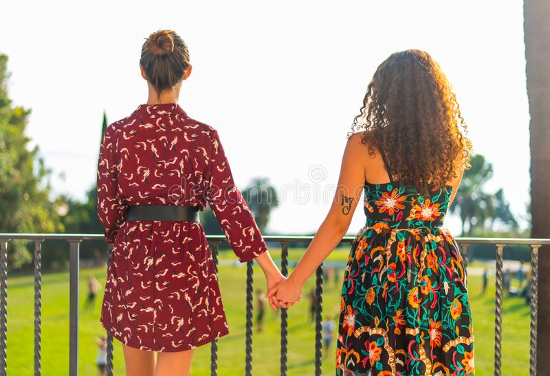Two girls holding hands and having fun stock photo