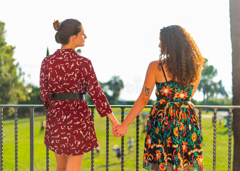 Two girls holding hands and having fun royalty free stock image