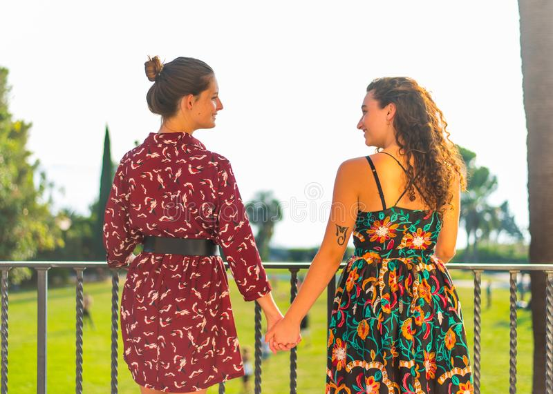 Two girls holding hands and having fun royalty free stock photo