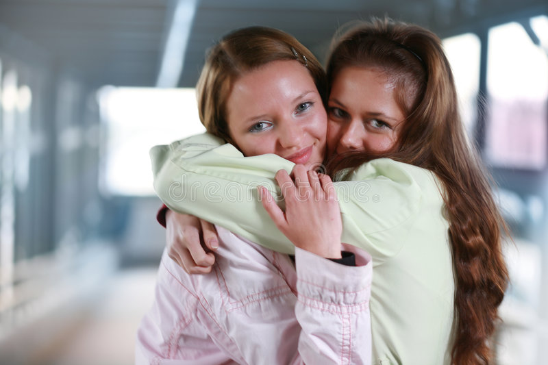 Two girls hugging. Best friends. Two girls hugging close-up, shallow DOF royalty free stock photos