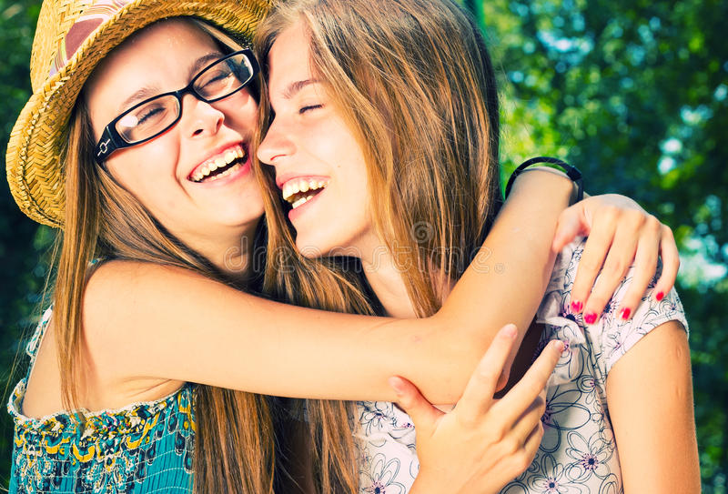 Two girls hugging stock images
