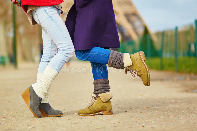 Two girls hugging on the street in Paris. Closeup of female legs, two girls hugging on the street in Paris, same-sex relationship concept stock images